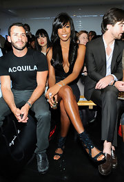 Kelly sported a sexy LBD with crystal-detailed cutout sandals.