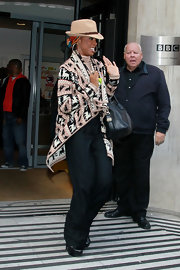 Kelly Rowland kept covered outside Radio Two in a reindeer fair isle cardigan and a turtleneck.