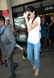 Kendall Jenner spiced up her casual tee and jeans combo with chic nude cutout booties by Aquazurra.