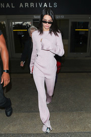 Kendall Jenner matched her top with a pair of lilac knit pants.