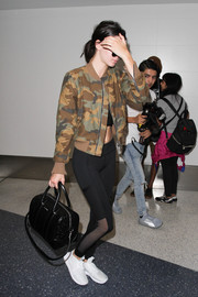Kendall Jenner was spotted at LAX looking tough in a camo-print bomber jacket.