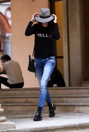 Kendall Jenner finished off her outfit in rugged style with a pair of ripped jeans.