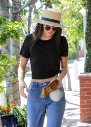 Kendall Jenner donned a Janessa Leone straw hat and a pair of round sunnies for some sun protection while out running errands.