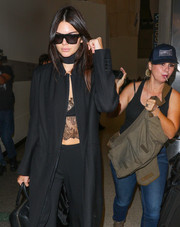 Kendall was a vision in black while traveling through LAX.
