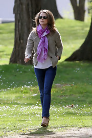 Keri Russell added feminine color to her get-up with a purple print scarf while filming 'Wilde Kingdom.'