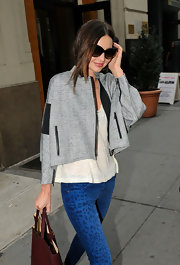 Miranda Kerr pulled her effortless outfit together with a cropped gray tweed jacket.