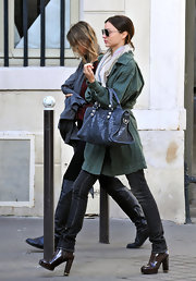 Miranda strutted down the street in Paris wearing a polished pair of chunky-heeled, brown leather boots.