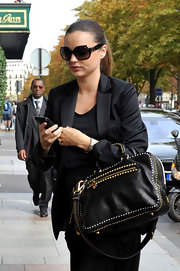 Miranda was spotted in Paris where she showed off her studded leather shoulder bag.