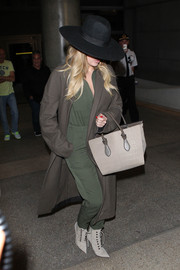 For her footwear, Khloe Kardashian chose a fiercely stylish pair of gray Balenciaga lace-up boots.