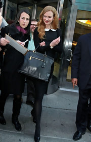 Nicole Kidman looked posh carrying a Prada large frame tote. The black leather purse perfectly complemented Nicole's timeless look.