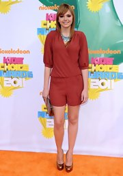 Aimee was playful at the Kids' Choice Awards in a red romper with bronze accessories.