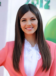 Victoria Justice arrived at the 2012 Kids' Choice Awards wearing her long locks in an ultra-straight style.