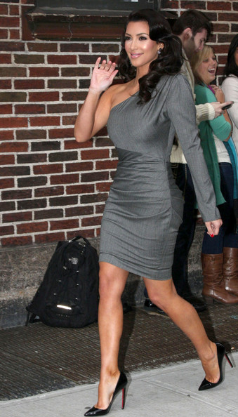 Kim Kardashian stops to pose and sign autographs before making an