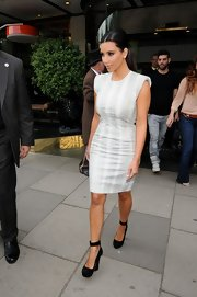 Kim Kardashian stepped out of her hotel wearing a pair of black pumps with ankle straps.