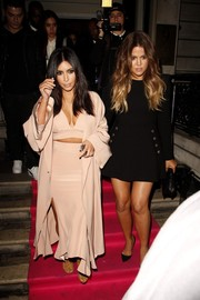 Kim Kardashian attended the Hairfinity launch wearing a boudoir-chic Juan Carlos Obando three-piece ensemble, consisting of a coat, crop-top, and long skirt.