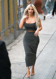 Kim Kardashian styled her matchy-matchy outfit with sexy ankle-wrap sandals by Merah Vodianova.