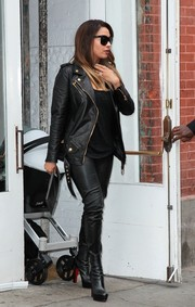 La La Anthony rocked leather-on-leather with this biker jacket and skinnies combo while out and about with pal Kim Kardashian.