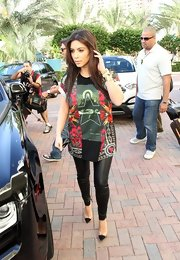 Kim Kardashian traded in her curve-hugging outfits for this loose Givenchy Birds of Paradise tee for a day out in Miami.