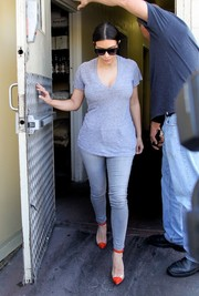 Kim Kardashian went casual and monochromatic with this gray Splendid V-neck tee and Bleulab skinny jeans combo for a day of errands.