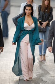 Staying true to the runway look, Kim Kardashian completed her Ulyana Sergeenko ensemble with a flowy teal robe.
