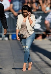 Kim Kardashian added a rugged touch to her look with a pair of ripped skinny jeans.