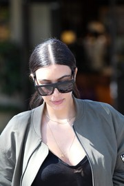 Kim Kardashian made her way to the salon wearing a pair of oversized square shades.