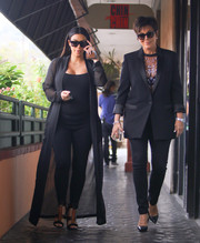 Kris Jenner went for a mannish look in this black suit for a lunch date with daughter Kim.