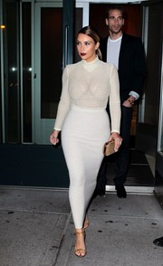 Wearing a white Veronique Leroy mesh bodysuit and a tight maxi skirt, Kim Kardashian managed to look oh-so-sexy without showing too much skin.