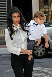Check it out... little Mason Disick wore a dotted bowtie!  Cute.