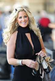 Kim Zolciak wore a pair of oversized hoop earrings while traveling through LAX airport.