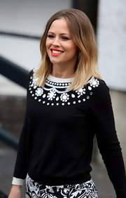 Kimberley Walsh's coral lip color provided a bright finish to her look during her visit to the London Studios.