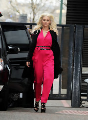 Kimberly Wyatt punctuated her ultra-bold hot pink jumpsuit with a black coat and matching heels.