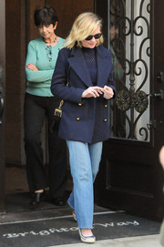 Kirsten Dunst looked toasty in a navy pea coat while out and about in Beverly Hills.