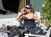 Somehow Victoria Beckham still looks fashionable, even when she's dressed down in a headband and pounding a glass of wine.