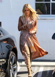 Khloe Kardashian looked fierce in Sergio Rossi suede thigh-high boots teamed with a silk coat while visiting a studio.