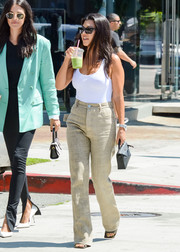Kourtney Kardashian paraded her figure in a white bodysuit by  Wolford while out in LA.