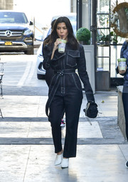 Kourtney Kardashian donned a utilitarian-chic jumpsuit by Orseund Iris, in black with white stitch detail, for a day out in LA.