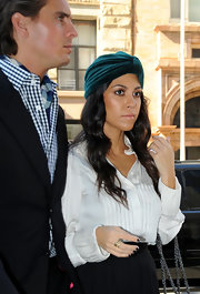 Kourtney completed her sophisticated uptown look with an emerald green head wrap.