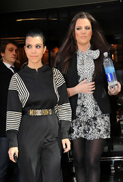 Kourtney wears a Moschino snake embossed leather belt over her jumpsuit while out with her sister in NYC.