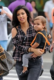 Mom Kourtney styled her son Mason's hair in a simple straight cut with longer tresses in the back.