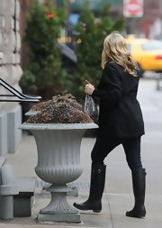 Jane Krakowski stayed dry in NYC in a pair of black rain boots.