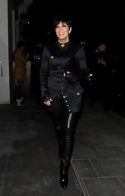 Kris Jenner chose this fitted, satin evening coat with gold button embellishments for her look while going out in London.