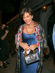 Kris Jenner was spotted outside Craig's holding a black purse that was adorned with a bejeweled tiger.