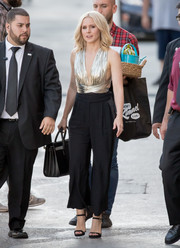 Elegant black ankle-strap heels by Jimmy Choo finished off Kristen Bell's outfit.