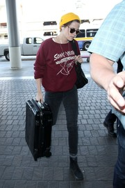 Kristen Stewart made her way to the airport carrying a Rimowa suitcase.
