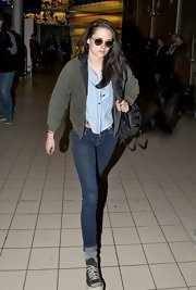 Kristen Stewart trekked through the airport in her typical uniform of cuffed skinny jeans and well-loved Converse.