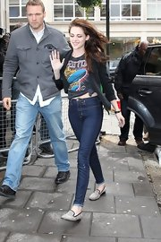 Kristen Stewart left her long locks flow freely in the breeze while making a visit to Radio 1 in London.