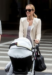 Kristin Cavallari's fitted cream jacket looked totally cool and contemporary on the young star.