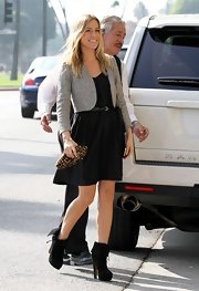 K. Cav paired her pretty black frock with black suede plaform ankle boots.