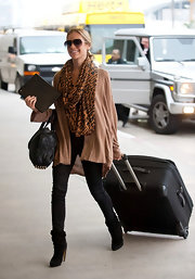 Kristin Cavallari traveled in style in skinny jeans and black suede ankle boots.